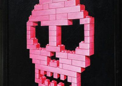 Maleri af pink lego kranie